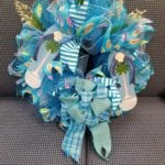 Flip flop wreath • Locally made wreaths, this one highlighting flip flops with beautiful beachy colors.