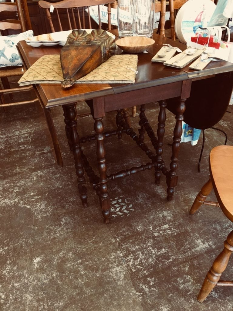 Vintage Gateleg Table • This Gateleg table is great for a small dining area.  It can be kept small for 2 people or expands within itself to seat 6!  Made of Mahogany, the table dates back to 75 years and is great shape!