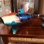 Fish wine bottle • This whimsical metal Fish with a wine bottle body would be a great conversation piece in your home.  Handmade by a local Artist the fish is painted with bright colors and body has a cobalt blue wine bottle.