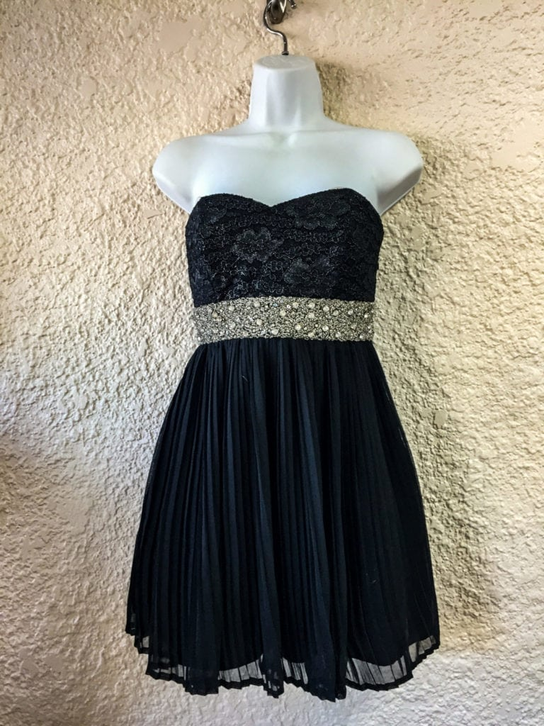 Black Strapless Party Dress • Beautiful black, strapless party dress with rhinestone waistline. This dress is adorable on and will be noticed by all. Size 6