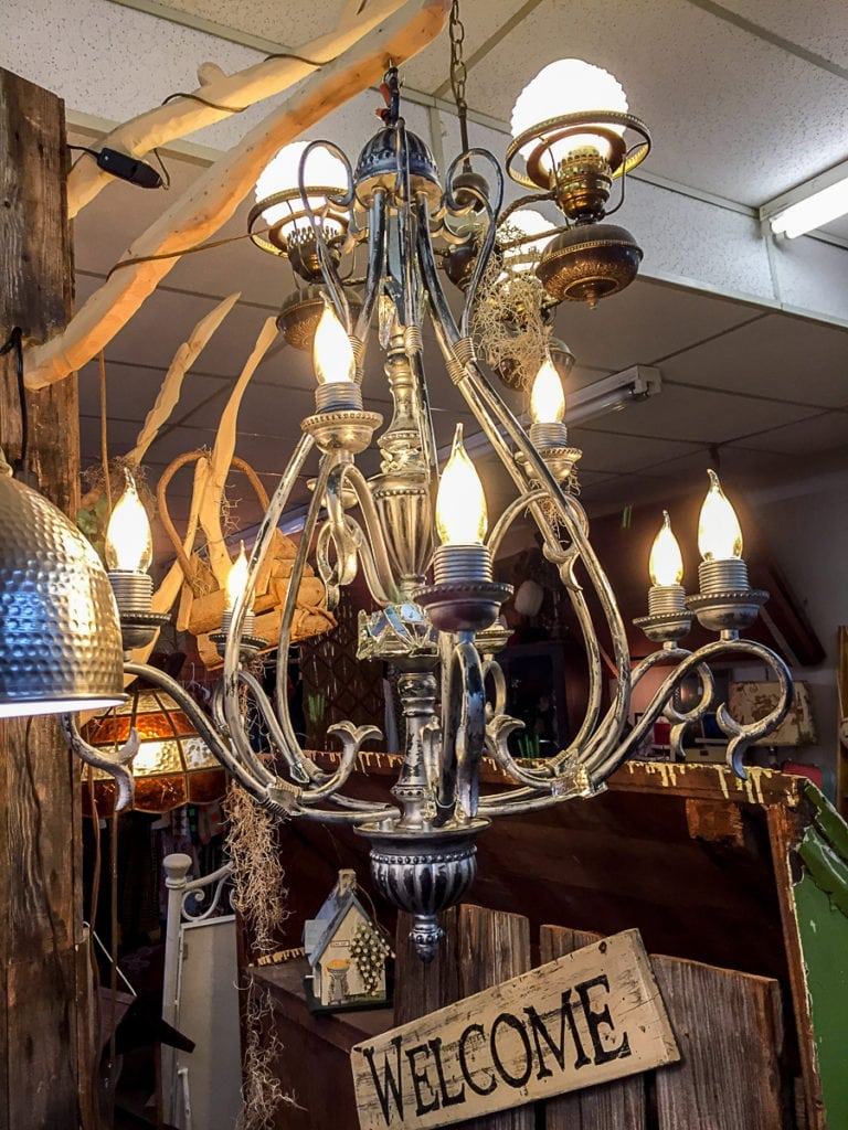 Unique Chandelier • This lovely vintage chandelier is artistically decorated with touches of 100 year old glass. This one of a kind piece will add elegance to any dining room. A must see!