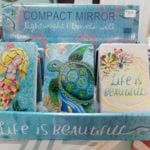 Compact Mirrors • Beautiful whimsical art on the compact. Open the compact for two mirrors on the inside, one is a regular mirror snd the other is a magnifying mirror. Great gift ideas!