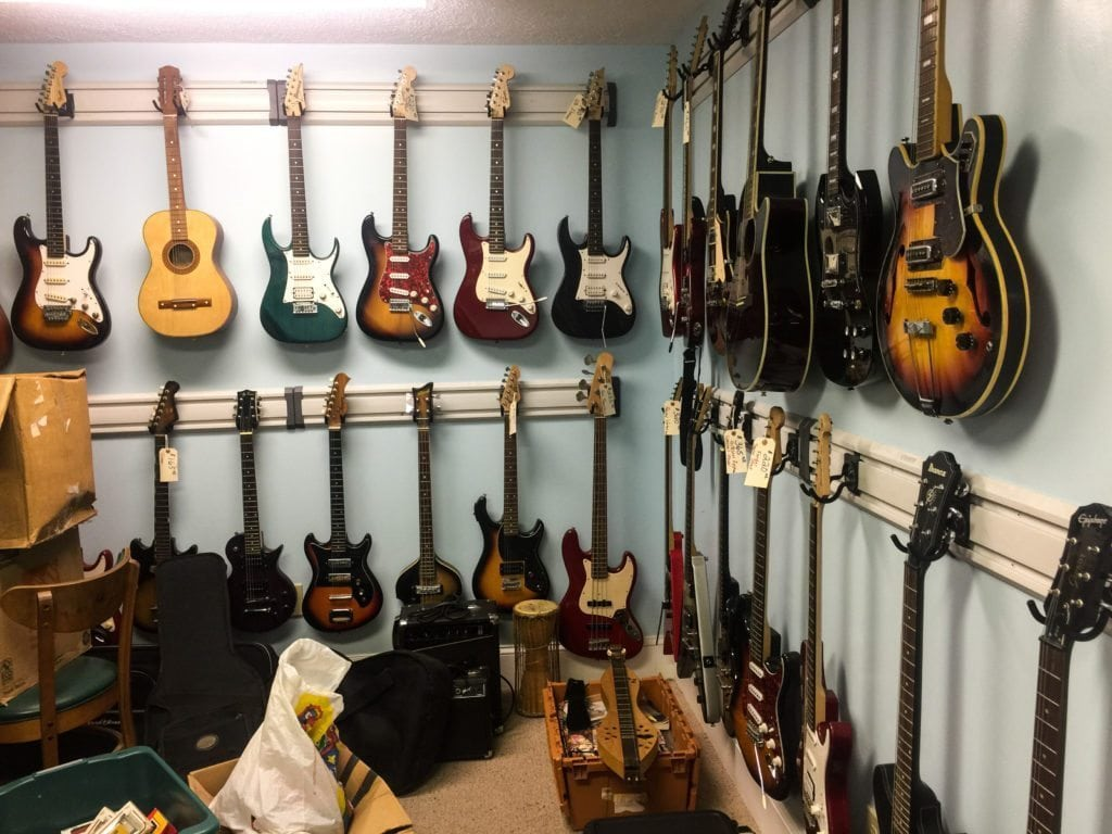 Guitars And Musical Instruments •