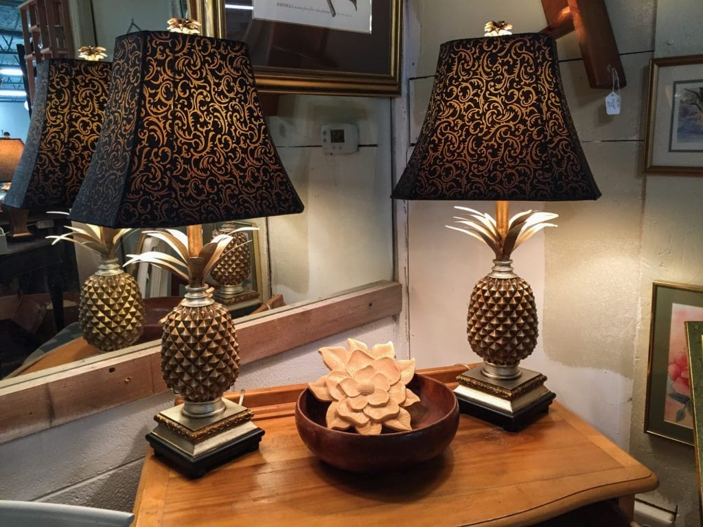 "Pineapple Lamps • The pineapple is a traditional southern symbol of hospitality.  These beautiful lamps will make any room in your house feel welcoming. Measuring 30"" high with a 6 1/2"" square base. They are priced separately and will be discounted if purchased together."