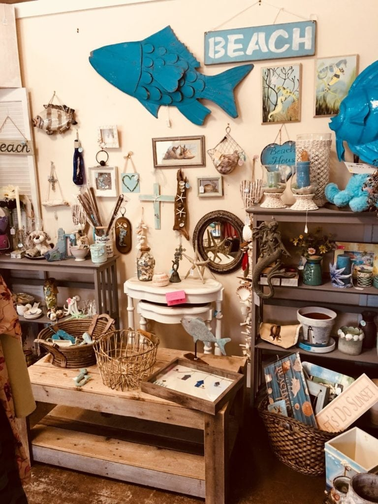 Beach decor galore! • Many different items to decorate your Coastal home with.  Candle's, metal art and lots of shells decorator!  Also a lot of gift ideas for the Holidays!