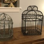 Vintage decorative birdcages • Decorative birdcages. One with a hanging chain and one with a bird in birds nest inside. Add some wintery greenery and they'd be perfect in your seasonal decor!