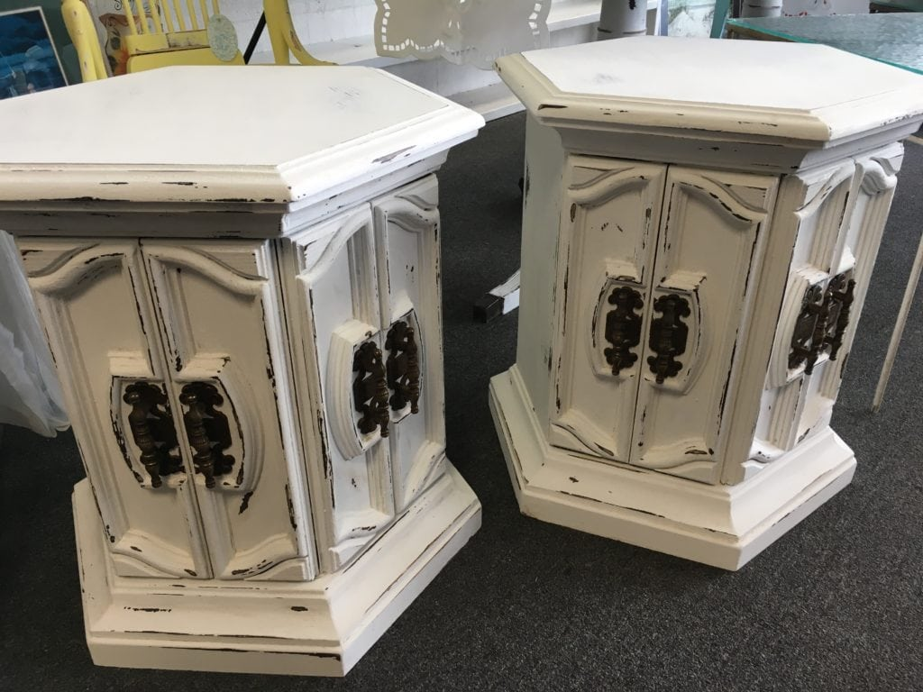 Chalk Paint End Tables • Very unique chalk painted matching hexagon tables, perfect for a unique spin on night stands or living room end tables. Original decorative hardware with storage underneath.