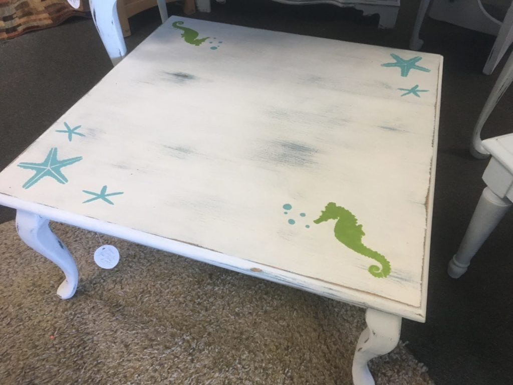 Coastal Coffee Table • What a fun and whimsical table for your beach house or family room, this square coffee table is painted with white chalk paint and lightly distressed and just for fun we've added a few starfish & seahorses!