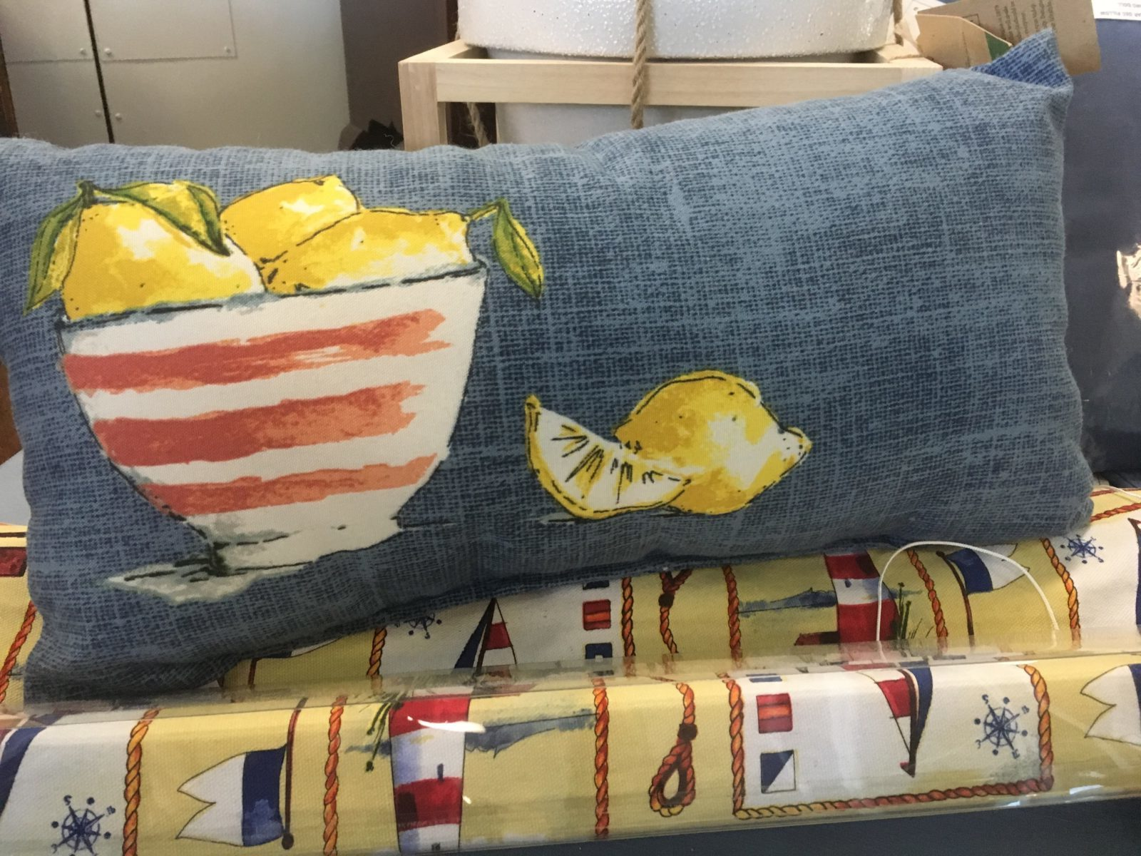 Outdoor Accent Pillow • Canvas outdoor pillow with whimsical lemons in a bowl adds a pop of color to any space, indoor or out!