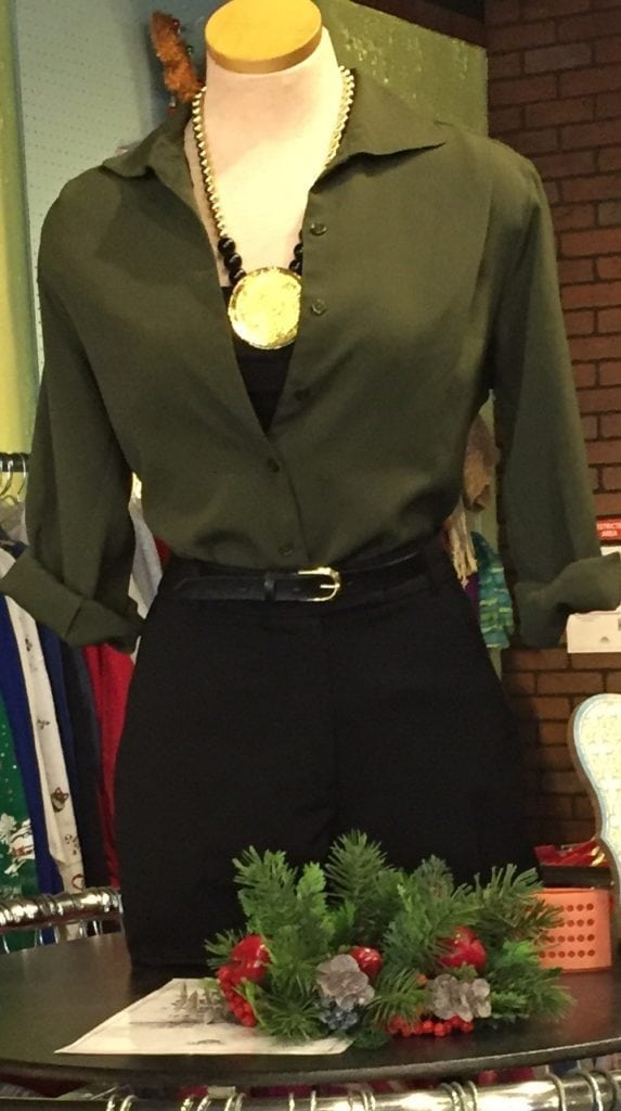 Green and black ensemble • Green and black ensemble paired with a black a gold necklace. All items sold separately.
