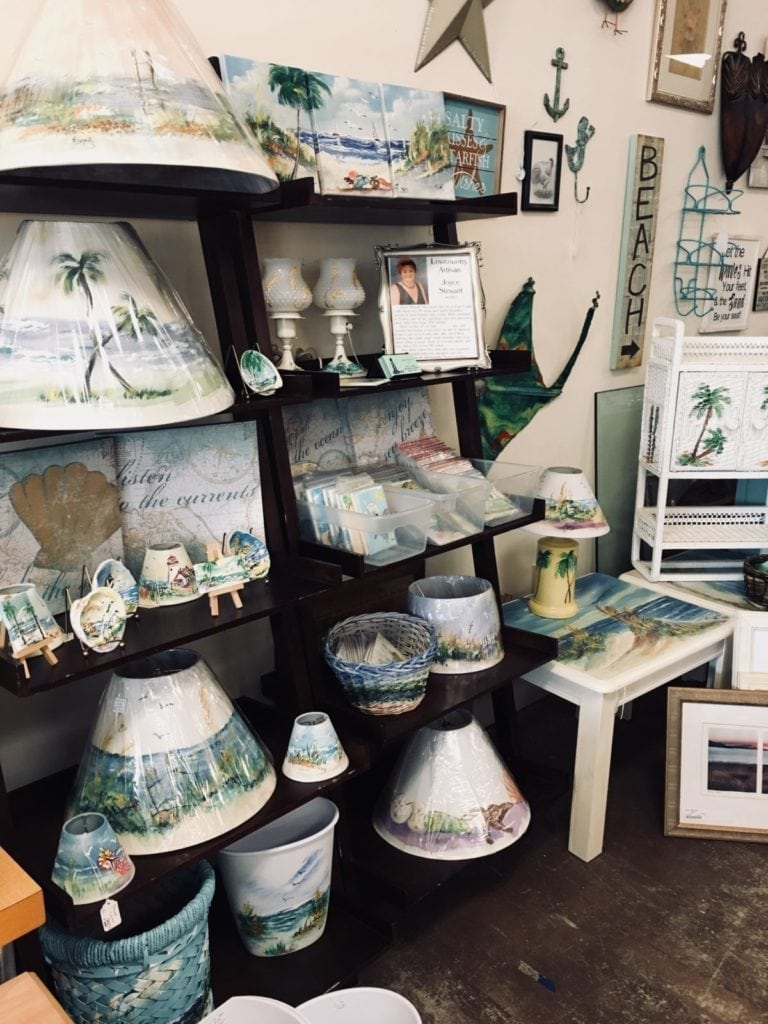 Local Artisan shop • Local Artist Joyce Stewart painted items would be a unique addition to your home.  From lamp shades to switch plate covers each is hand painted with a coastal scene!