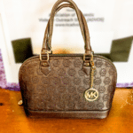 Michael Kors Handbag • Beautiful brown Michael Kors Handbag. This handbag is in very good condition and it just waiting for a new owner!