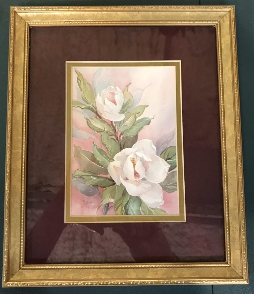 Magnolia flower print • We love magnolias! This gorgeous print is double matted in gold and cranberry and sits in a 10x12 gold frame. This lovely piece will add sweet southern charm to any decor! Come see it in person to appreciate its beauty!
