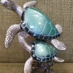 Turtles on coral • This resin statue of 2 turtles has beaitiful colors that you can use anywhere in your home.