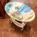 Local Artist handpainted • Hand painted by a local Artist, this end table has storage for magazines on the bottom.  It would make a great addition to your beach home!