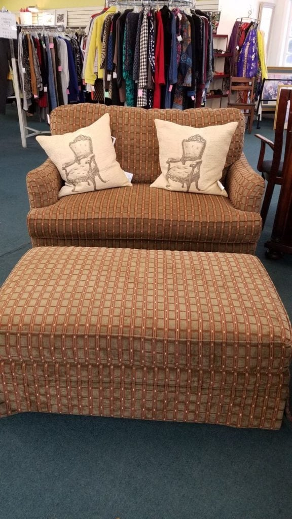 Brown tones loveseat & ottoman • Each piece sold separately.  Large ottoman on wheels.