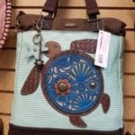 Chala crossbody bag • This whimsical turtle crossbody is the perfect size! Stop by and see our total collection. We can also special order for you if you don't see what you want.