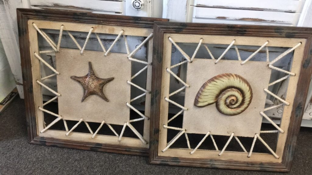 Coastal Decorative Wall Art • Very distinctive wall art/decor featuring raised coastal designs, distressed wood frames and rope detailing. Sold as a set, they would look perfect hung over a console table or bed. Bring home the beach with a touch of coastal elegance.