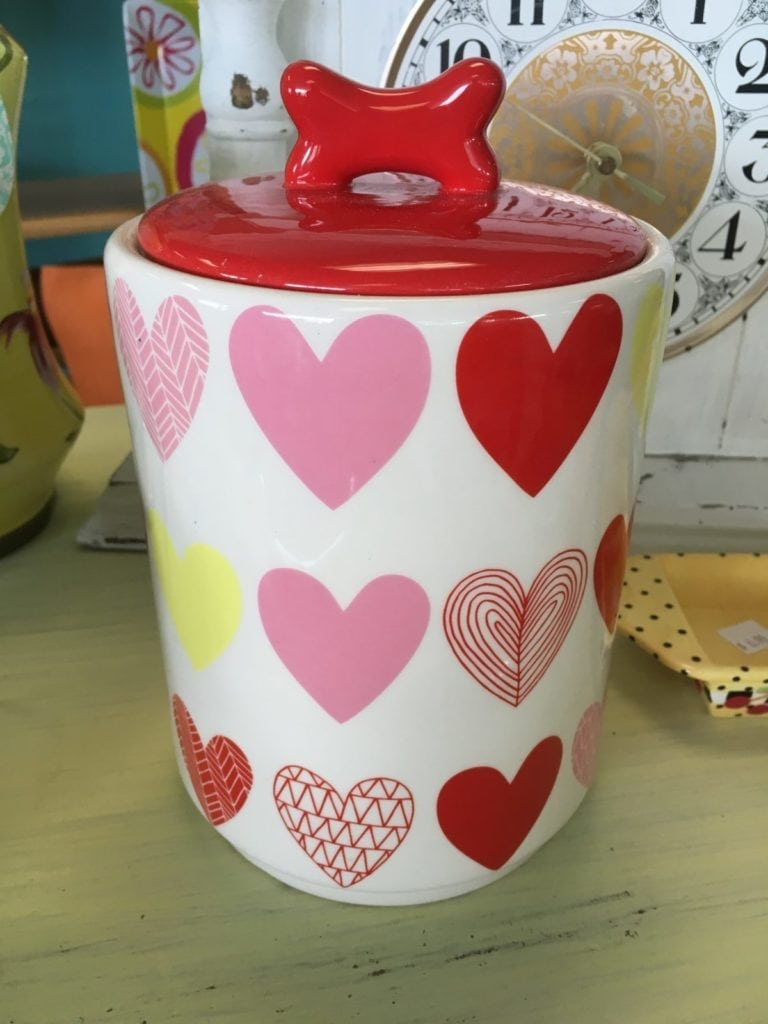"""Heart Doggy Treat Jar • Charming ceramic doggy treat jar with a bone as the handle on the lid and an assortment of hearts on the actual jar. Keep doggy treats or be creative and store cotton balls, candies or anything else your """"Heart"""" desires."""
