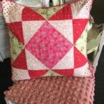 "Heart Quilted Pillow • Charming hand made Pillow with assorted heart fabrics Quilted into a decorative 18"" x 18"" Pillow with a piped pink edge. Split back for cleaning or changing the insert out."
