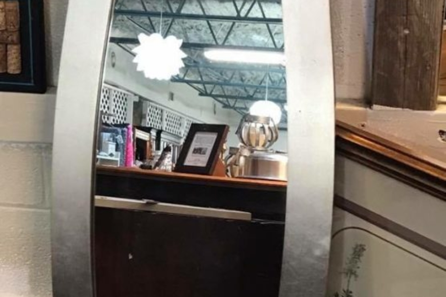"""Bassett Chevel mirror • Look at those curves! This mirror would be lovely hung vertically in a dressing room or hang it horizontally over a buffet in the dining room or fireplace. Silver frame. Measures 62""""x16"""""""