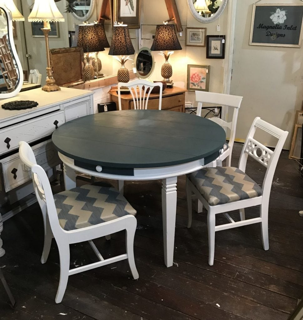 Dining table and four chairs • ReDesigned round dining table & four chairs. Each chair is unique, and coordinates beautifully with this lovely Homestead Blue and bright white. Table is large enough to seat 6. Four drawers for storage-napkins, flatware, etc.