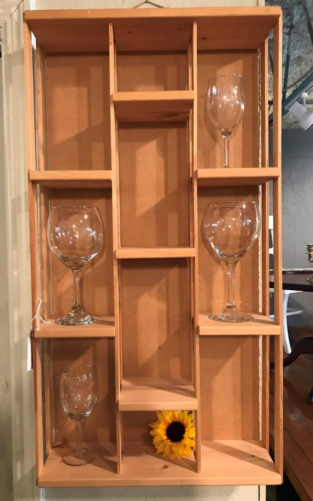 Hanging wood display shelf • Let us customize the finish fit you in this great display shelf. Here we're using it to display wine glasses, but you can display any of your prizes here. 