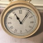 """Vintage Style Clock • We updated from antique brass to this antique white to make this clock a great statement piece for any room & accent to any decor. Measures 14"""" high and 12"""" wide. Battery operated. Do you have a housewarming, anniversary or wedding coming up? Great gift!"""