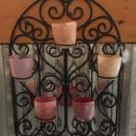 Colorful Votive Holder • Metal and colored Glass combine in this fabulous hanging votive holder. Imagine this on your sun porch or back deck, with the colorful light flickering as you enjoy your favorite cool beverage, listening to your favorite music. How relaxing!