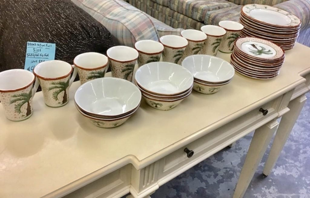 39 piece palm tree dinnerware • This is a 39 pc. Palm tree dinnerware set from totally today. 13 dinner plates, 10 salad plates, 9 mugs, 7 cereal bowls. Replacements unlimited retail on these pieces are $380.00 This set is less than half price of what The value is