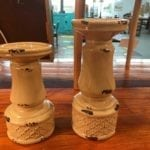 Ceramic pillar candleholders • This pair of ceramic pillar candleholders are a lovely creamy yellow with a rusty distressed look. Candles add lovely ambiance in any room, and this pair is a great neutral color that will compliment any decor.