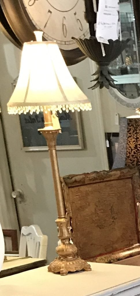 Pair of Candlestick Lamps • Goldtone Candlestick Lamps with offwhite shades accented with crystal trim. We love them on a buffet, but these heavy, well made lamps would be great anywhere. Price is for the pair.