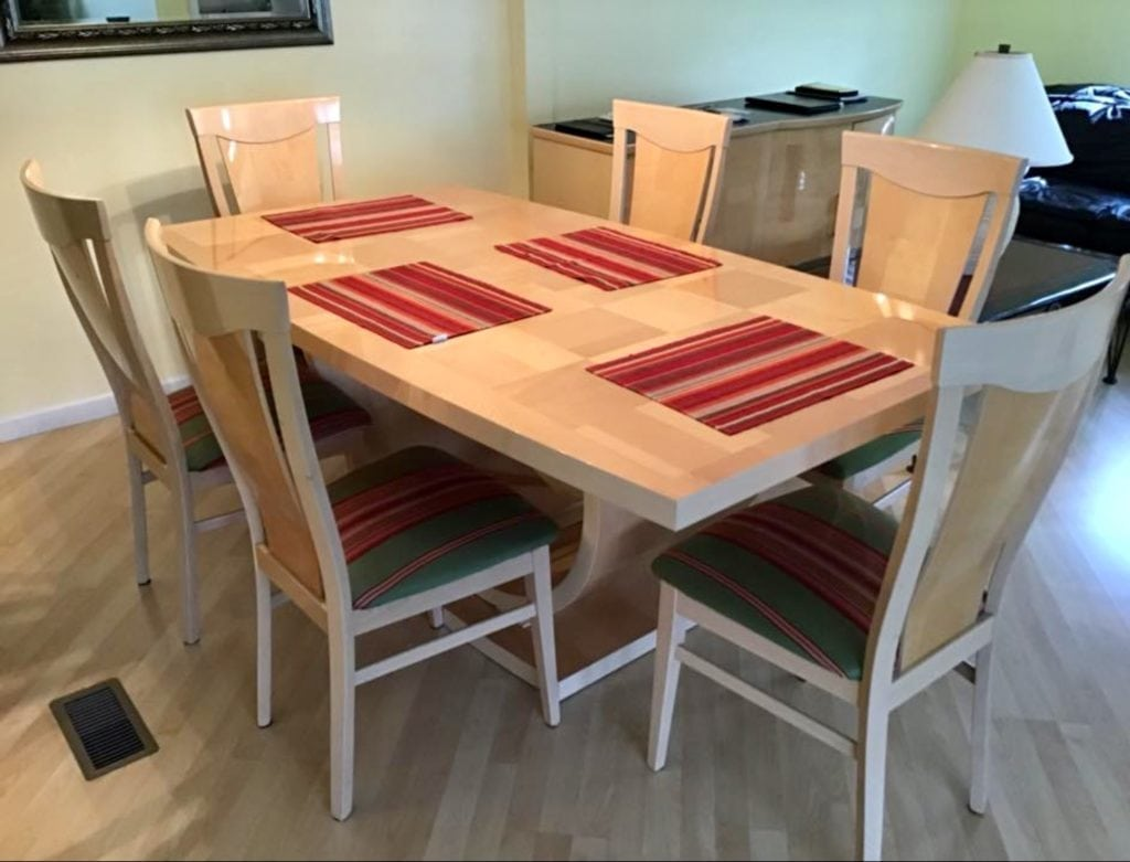 "Italian LAQUERED Table 6chairs • Great buy on this lacquered finished table with hidden leaf and six fabric chairs. This set was made in Italy and is in like new condition. 73"" by 43"" without leaf in. Very cool lines very heavy and sturdy. Must see to appreciate its value.In Italy $1600+"