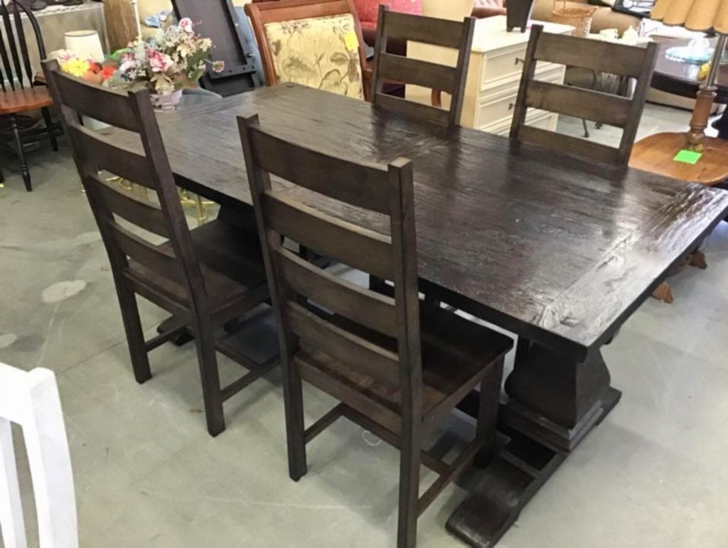 WorldMarketExtensionTable4chairs • Great buy on this very gently used world market extension table with four chairs. These garner chairs run new $279.00 for two. Owner paid $558.00 for four chairs and $650 for table. Unique table design has two extensions that clip on to each end extending