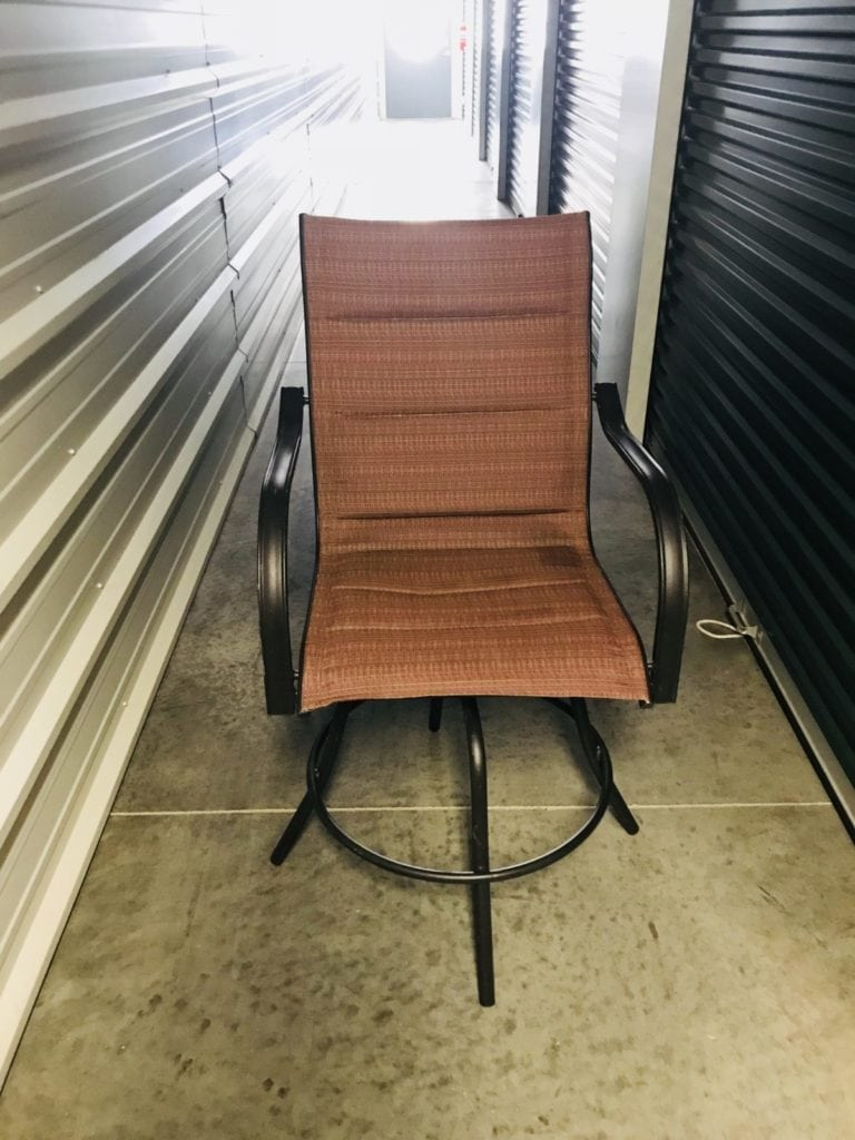 Outdoor patio table & 2 chairs. • Bar height patio table and two swivel chairs. Lightly used and in great condition.