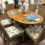 Oval Dining Set w/ 6 chairs • Beautiful oval dining table with 6 chairs. Chairs have a pineapple pattern fabric with a white background. Chairs are a woven rattan and very comfy.