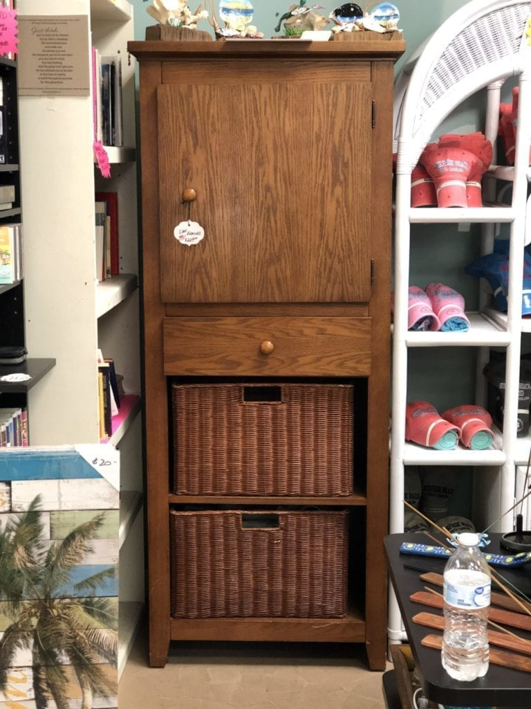Oak Armoire • Beautiful oak armoire with a cabinet door, one drawer and two baskets below. Great for any entrance to stow shoes, compact umbrellas and more. A pretty piece for any home. On sale for $199