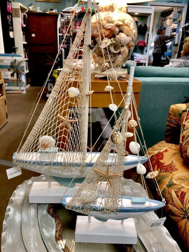 Decorative Sailboats with Netting • Unique wooden decorative sailboats with netting and shells. Perfect for that beach room or sunroom. Large is $35 and small sailboat is $15