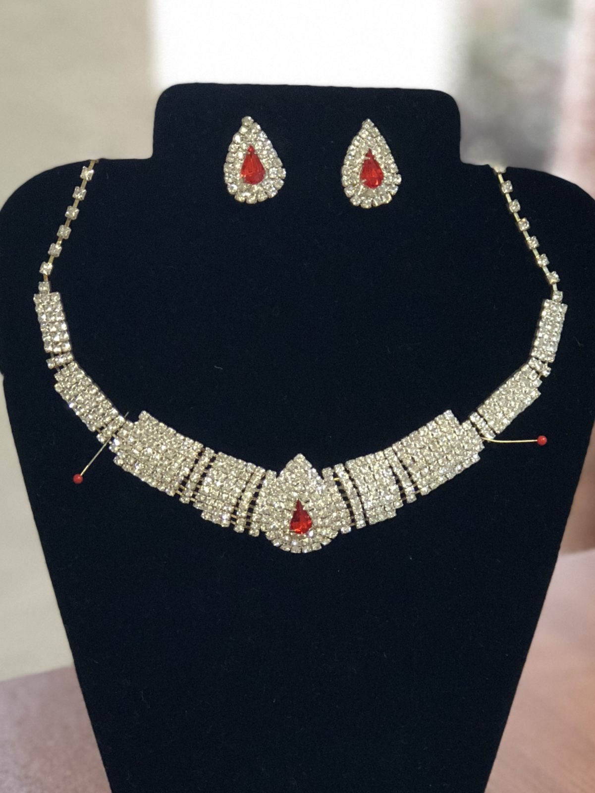 Gold Rhinestone/Ruby Necklace Set • Beautiful gold tone rhinestone and ruby necklace set.  Will make any red dress or outfit pop.