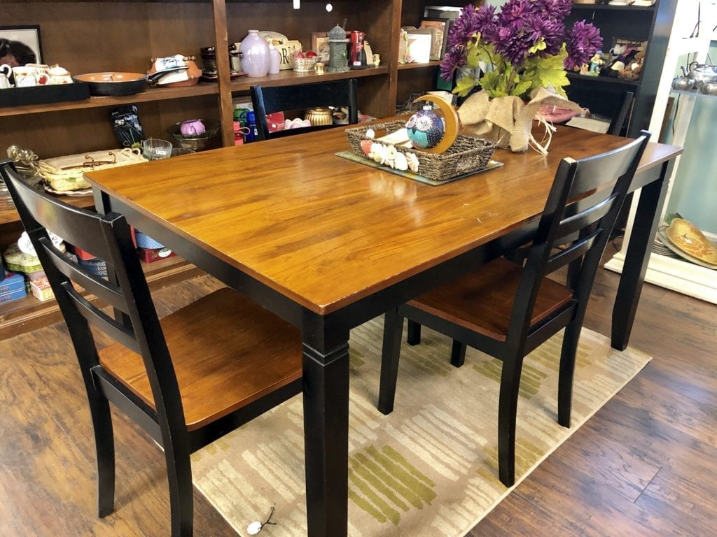 Wood Rectangle Dining Set • Lovely rectangle wood dining set with 4 chairs. Accent of black makes this a stunning piece. 36' x 60'