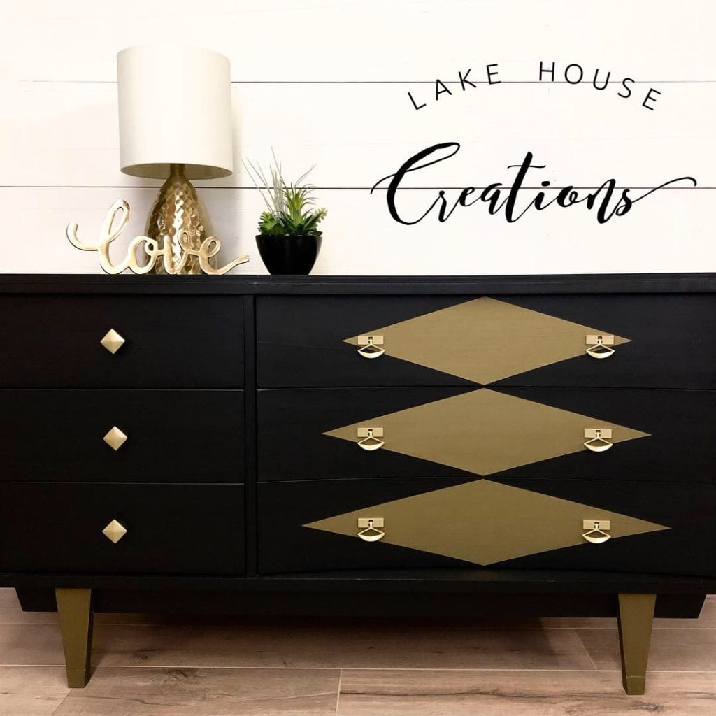 Vintage Mid Century Modern Dresser • This dresser has been refinished in Coal Black with bronze metallic accents. Large drawers feature a unique curved shape. 